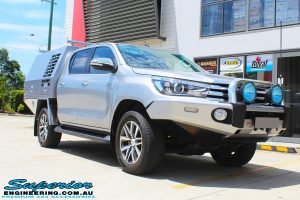 "Right front side view of a Grey Toyota Hilux Revo before fitting a Superior Remote Reservoir 2"" Inch Lift Kit"