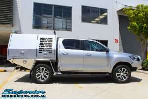 "Side view of a Grey Toyota Hilux Revo before fitting a Superior Remote Reservoir 2"" Inch Lift Kit"