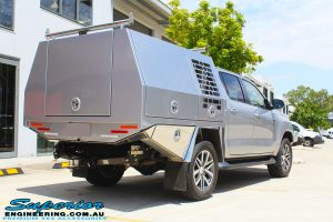 "Rear right view of a Grey Toyota Hilux Revo before fitting a Superior Remote Reservoir 2"" Inch Lift Kit"