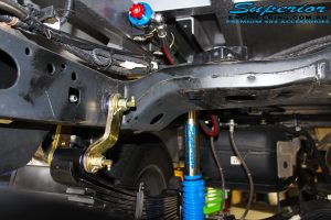 Right rear underbody view of a Superior Remote Reservoir Shock with Leaf Spring fitted