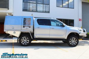 "Side view of a Grey Toyota Hilux Revo after fitting a Superior Remote Reservoir 2"" Inch Lift Kit"