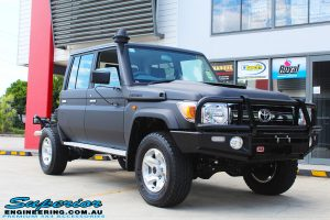 """Right front side view of a Black Toyota 79 Series Landcruiser Dual Cab before fitting a Superior Remote Reservoir 2"""" Inch Lift Kit with Airbag Man Leaf Air Kit"""