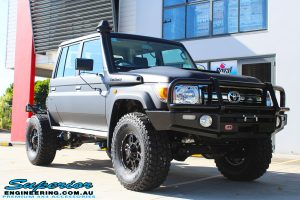 """Right front side view of a Black Toyota 79 Series Landcruiser Dual Cab after fitting a Superior Remote Reservoir 2"""" Inch Lift Kit with Airbag Man Leaf Air Kit"""