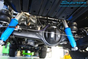 Rear underbody view of the fitted Superior Remote Reservoir Shocks, Leaf Spring and Airbag Man Leaf Air Kit