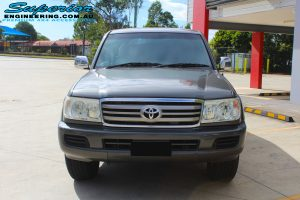 Front view of a Toyota Landcruiser 100 Series before fitment of a MCC Rocker Bullbar, Lightforce DL230 HTX's & GME TX3520s UHF