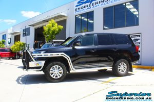 Left side view of a Toyota Landcruiser 200 Series before fitting the Superior OE 2.5 Remote Reservoir 2 Inch Lift Kit
