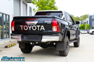 """Right rear view of a Black Toyota Hilux Revo after fitting a 2"""" inch lift with Superior Remote Reservoir Rear Shock & Front Strut and Coil & Leaf Springs"""