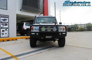 """Front view of a white single cab 79 Series Toyota Landcruiser before fitting a 4"""" inch Superior Remote Reservoir Superflex Kit + Tru Tracker Kit"""