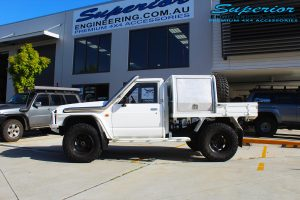 "Left side view of a White Nissan Patrol GQ Ute before fitting the 4"" inch Superior Superflex Kit"