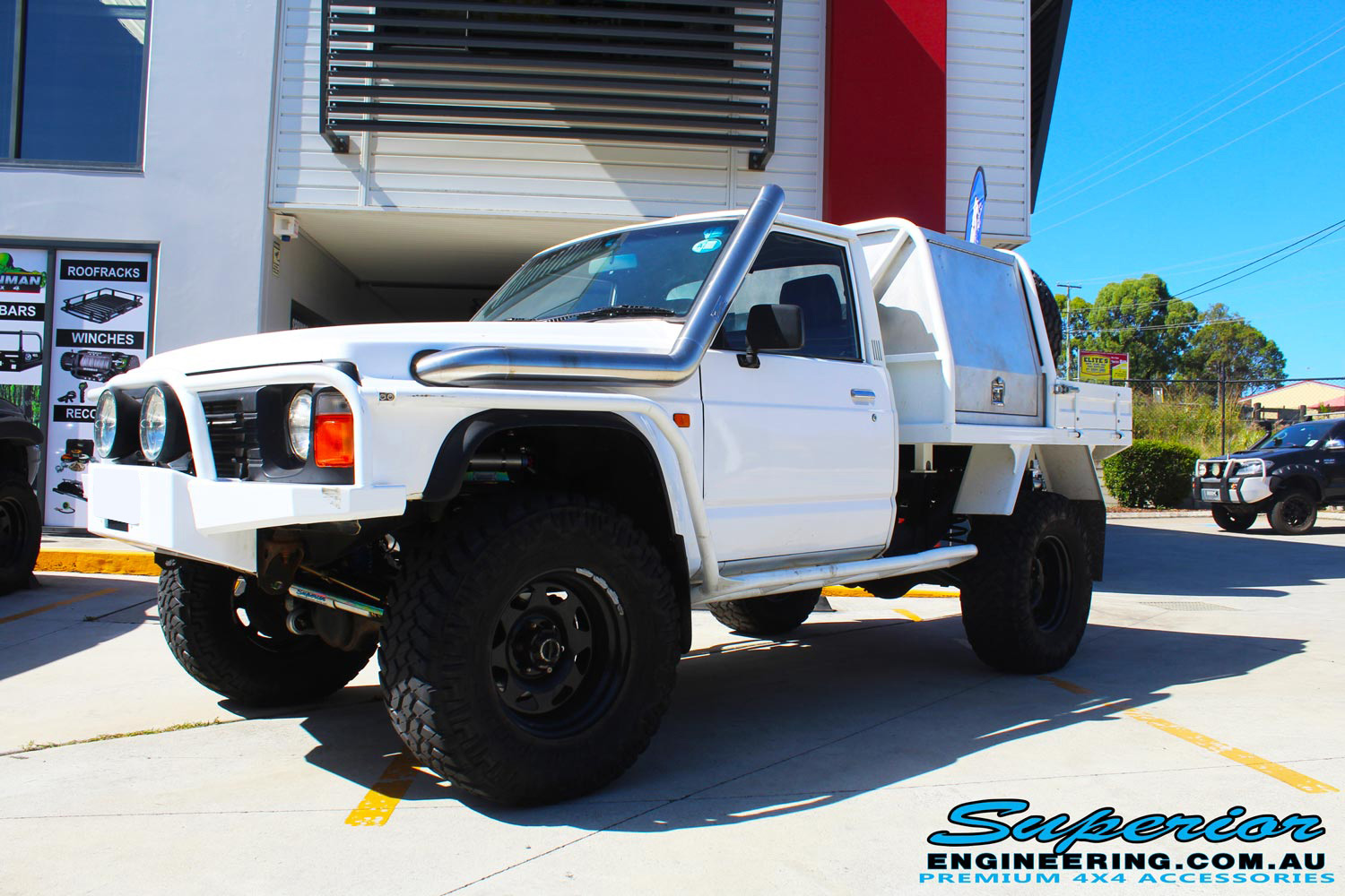 """Front right view of a White Nissan Patrol GQ Ute after fitting the 4"""" inch Superior Superflex Kit"""