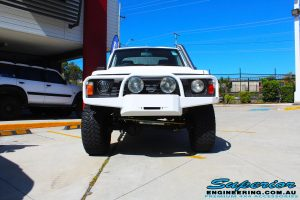 Front view of a White Nissan Patrol GQ Ute after fitting the 4 inch Superior Superflex Kit