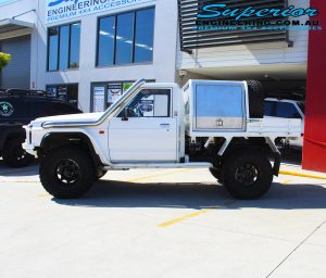 Left side view of a White Nissan Patrol GQ Ute after fitting the 4 inch Superior Superflex Kit