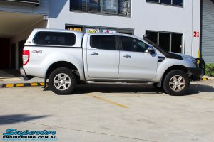 """Right side view of a Silver Ford PX Ranger before fitment of a Bilstein 2"""" Inch Lift Kit + Airbag Man Leaf Air Kit"""