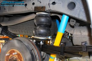 Rear right inside view of the fitted Bilstein Shock + EFS Leaf Spring and Airbag Man Leaf Air Kit