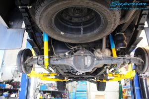 Rear underbody view of the fitted Bilstein Shocks + EFS Leaf Springs and Airbag Man Leaf Air Kit