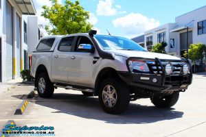 """Left front side view of a Silver Ford PX Ranger after fitment of a Bilstein 2"""" Inch Lift Kit + Airbag Man Leaf Air Kit"""