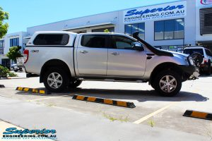 """Left side view of a Silver Ford PX Ranger after fitment of a Bilstein 2"""" Inch Lift Kit + Airbag Man Leaf Air Kit"""