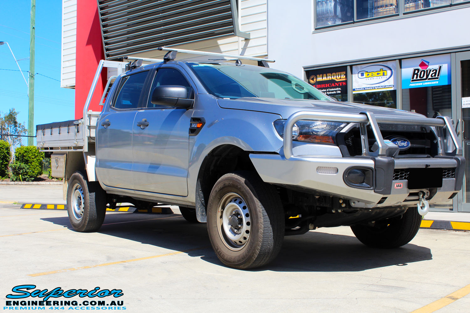 Right front side view of a Silver Ford PX Ranger after fitment of a EFS 40mm Lift Kit