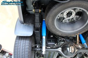 Rear underbody view of 2 fitted Superior Nitro Gas Shocks with Leaf Springs, Extended Shackles & U-Bolt Kit