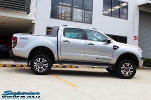 "Side view of a Grey Ford PX2 Ranger after fitment of a Superior Nitro Gas 4"" Inch Lift Kit + Superior Diff Drop Kit"