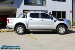 Right side view of a Silver Ford PXII Ranger before fitment of a Ironman 4x4 Long Range Fuel Tank + Protector Bull Bar