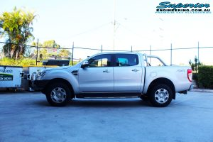 Right side view of a Silver Ford PXII Ranger after fitment of a Ironman 4x4 Long Range Fuel Tank + Protector Bull Bar