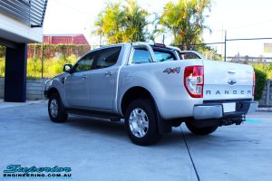 Rear right view of a Silver Ford PXII Ranger after fitment of a Ironman 4x4 Long Range Fuel Tank + Protector Bull Bar