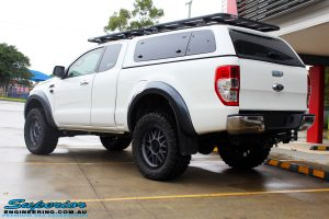Rear right view of a White Ford PXII Ranger after fitment of the Superior Diff Drop Kit