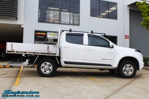 Side view of a White Holden Colorado RG before fitment of a Bilstein 45mm Lift Kit