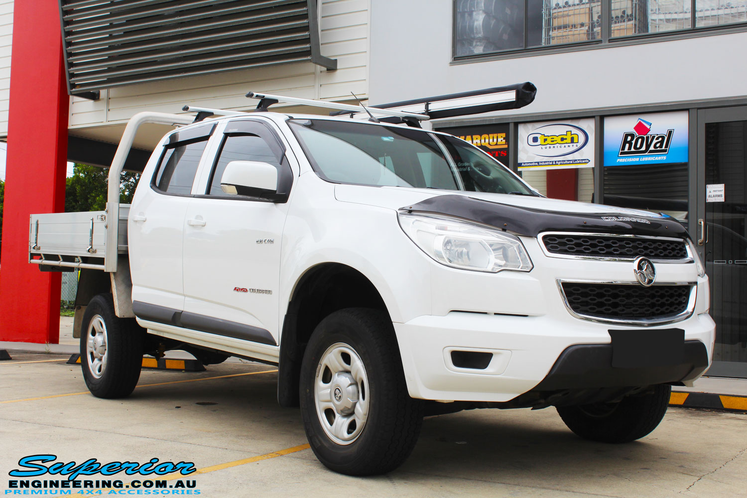 Right front side view of a White Holden Colorado RG after fitment of a Bilstein 45mm Lift Kit