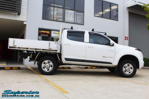 Side view of a White Holden Colorado RG after fitment of a Bilstein 45mm Lift Kit