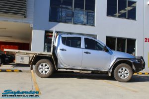 Side view of a Grey Mitsubishi MN Triton before fitment of a Bilstein 20mm Lift Kit