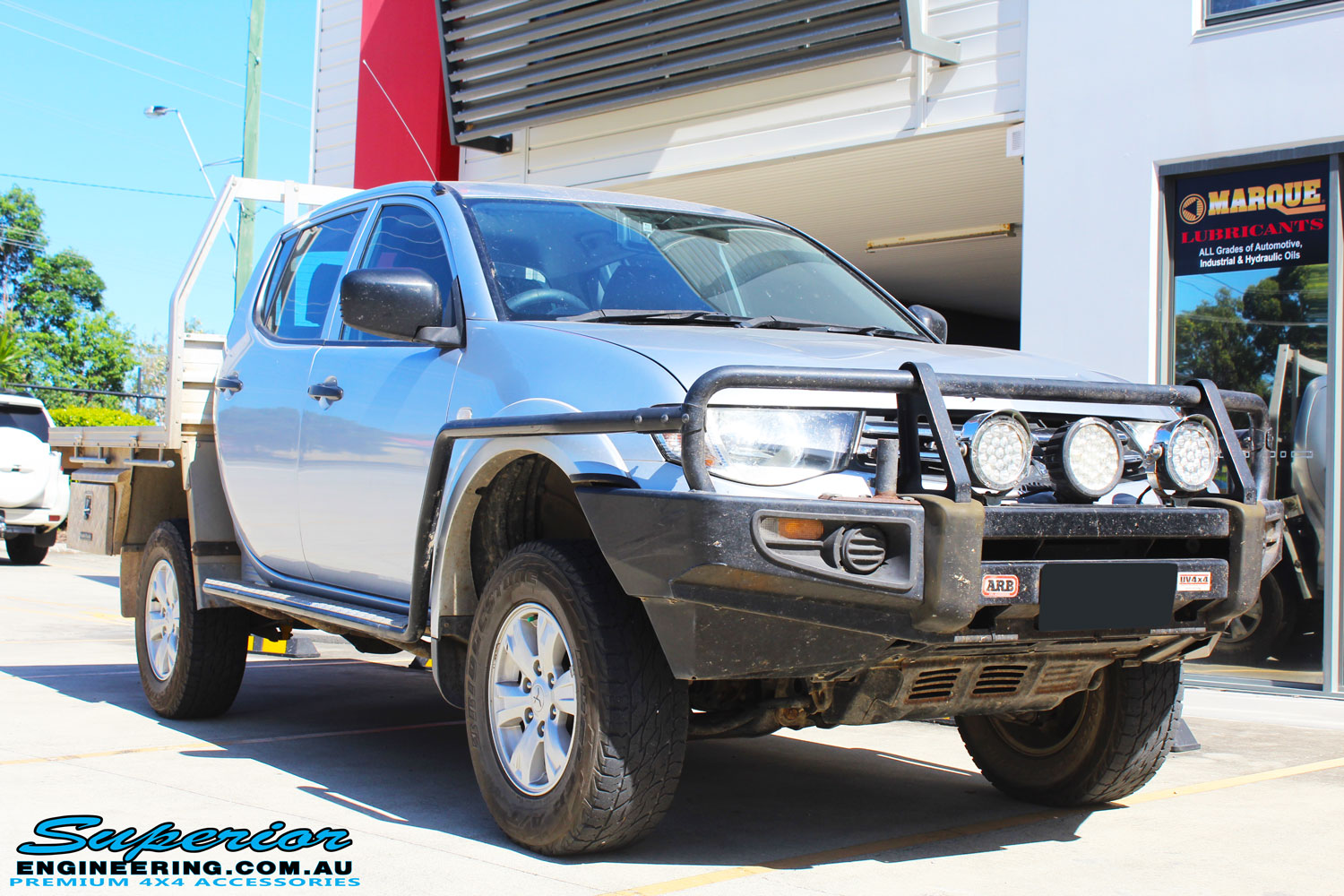 Right front side view of a Grey Mitsubishi MN Triton after fitment of a Bilstein 20mm Lift Kit