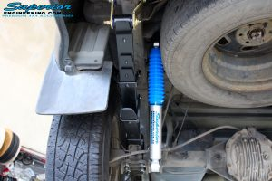 Rear left underbody view of the fitted Superior Nitro Gas Shock with Leaf Spring, Extended Shackles & U-Bolt Kit