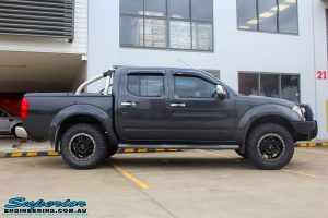 """Side view of a Nissan D40 Navara Dual Cab after fitment of a Superior Nitro Gas 2"""" Inch Lift Kit, Airflow Snorkel & Nitto Trail Grappler Tyres + Tuff T16 Alloys"""