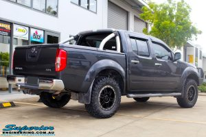 "Rear right view of a Nissan D40 Navara Dual Cab after fitment of a Superior Nitro Gas 2"" Inch Lift Kit, Airflow Snorkel & Nitto Trail Grappler Tyres + Tuff T16 Alloys"