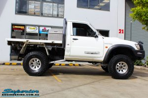 """Right side view of a White GU Patrol Ute after fitment of a Superior Nitro Gas Hyperflex 4"""" Inch Lift Kit, Tie Rod Heim Joint + Coil Tower Brace Kit"""