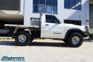 """Right side view of a White GU Patrol Ute before fitment of a Superior Nitro Gas Hyperflex 4"""" Inch Lift Kit, Tie Rod Heim Joint + Coil Tower Brace Kit"""