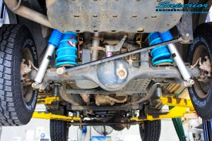 """Rear underbody view of both fitted 2"""" Nitro Gas Shocks with Coil Tower Brace Kit, Airbag Man Coil Air Helper Kit and Coil Springs"""