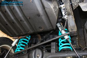 "Rear underbody view of both fitted Fox 2.0 Performance Series 2"" Remote Reservoir Shocks with Coil Springs"