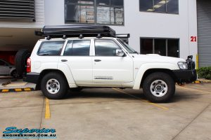 """Right side view of a White Nissan GU Patrol Wagon before fitment of a Fox 2.0 Performance Series 2"""" Inch Lift + Diff & Radiator Guard & Rock Sliders"""