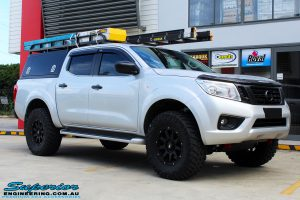 "Right front side view of a Grey Nissan NP300 Navara Ute after fitment of a Superior Nitro Gas 2"" Inch Lift Kit + Airbag Man 2"" Coil Air Kit Helper, Ironman 4x4 Flomax Air Compressor and Nitto Trail Grappler Tyres with King Gator Wheels"