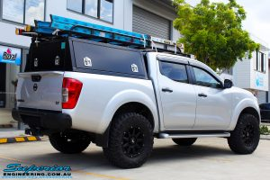 """Rear right view of a Grey Nissan NP300 Navara Ute after fitment of a Superior Nitro Gas 2"""" Inch Lift Kit + Airbag Man 2"""" Coil Air Kit Helper, Ironman 4x4 Flomax Air Compressor and Nitto Trail Grappler Tyres with King Gator Wheels"""