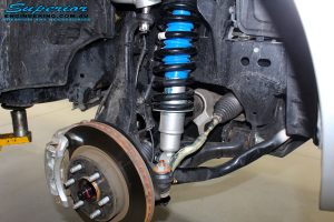 Front right inside guard view of the fitted Nitro Gas Front Strut, Coil Spring + Adjustable Upper Control Arms