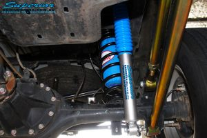 Left underbody inside view of the fitted Superior Nitro Gas Shock + Coil Spring with Airbag Man Coil Air Kit Helper and Lower & Upper Control Arms