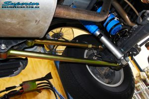 Right underbody view of the fitted Superior Nitro Gas Shock + Coil Spring with Airbag Man Coil Air Kit Helper and Lower & Upper Control Arms