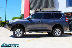 """Left side view of a Grey Toyota 150 Series Landcruiser Prado after fitment of a Superior Nitro Gas 2"""" Lift"""