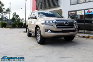 "Right front side view of a Gold Toyota 200 Series Landcruiser before fitment of a 2"" Inch Lift Kit"