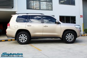 """Right side view of a Gold Toyota 200 Series Landcruiser before fitment of a 2"""" Inch Lift Kit"""