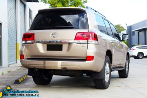 """Rear right view of a Gold Toyota 200 Series Landcruiser before fitment of a 2"""" Inch Lift Kit"""